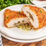 Chicken Kiev cut in half with compound butter spilling out.