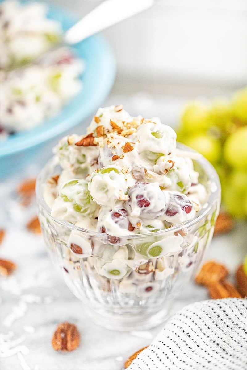 Creamy grape salad in a small glass bowl.