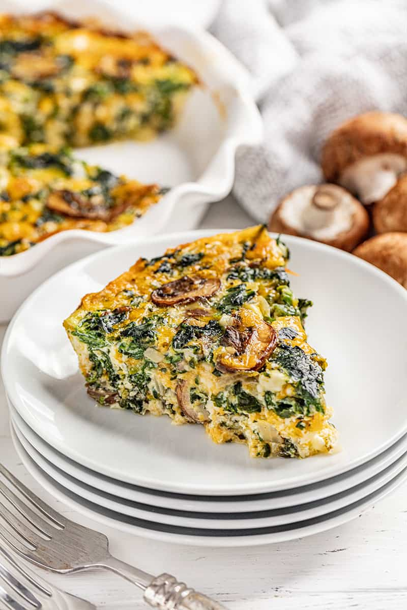 A piece of crustless spinach quiche on a plate.