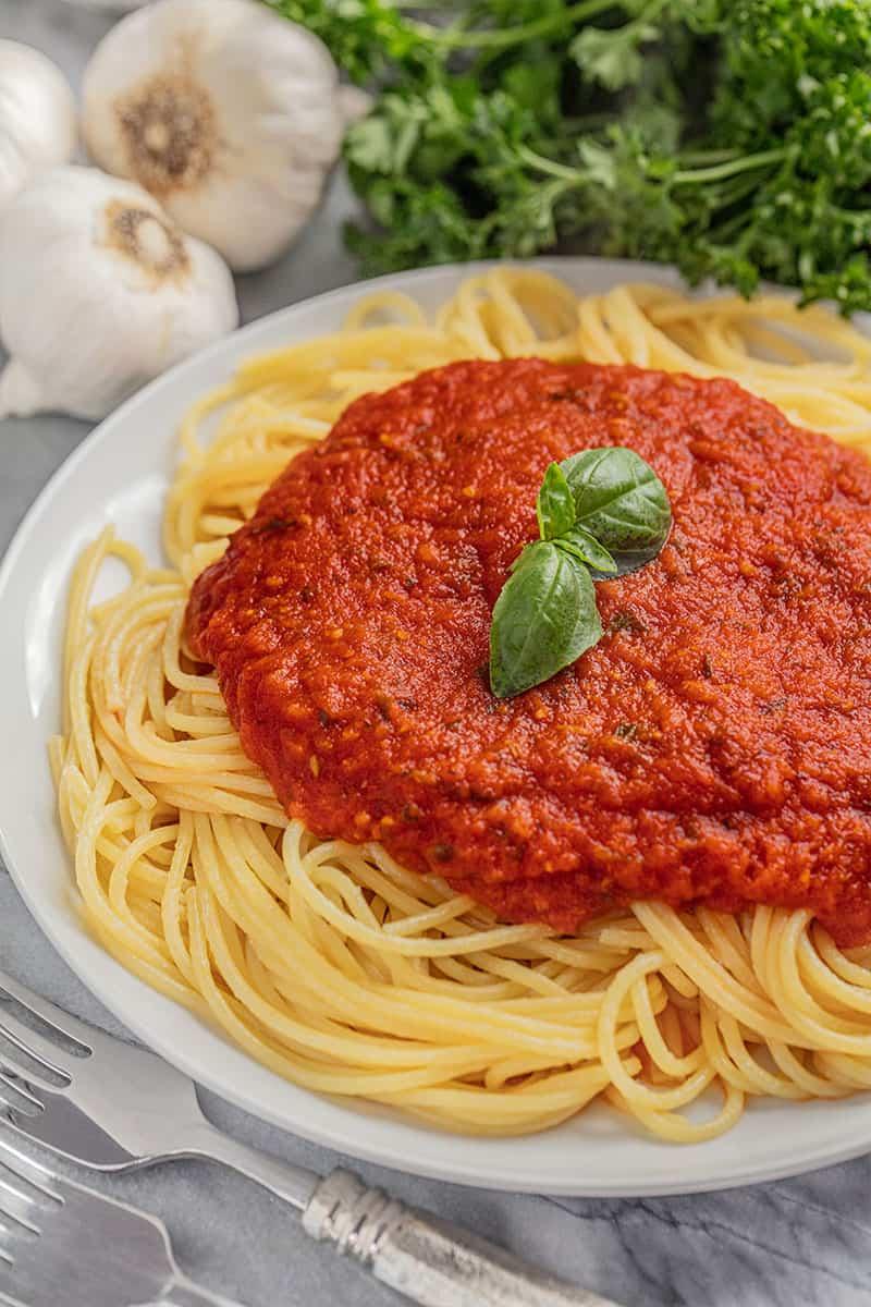 Spaghetti noodles and spaghetti sauce.