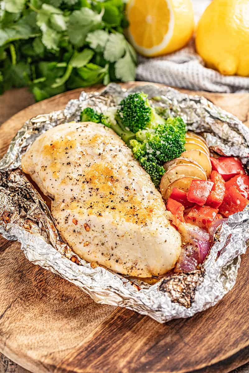 Cheesy ranch chicken breast and veggies in a foil packet.