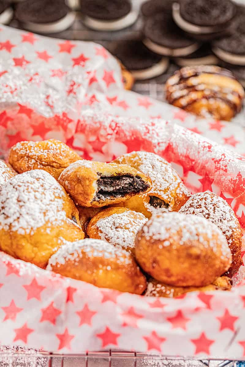 Deep fried Oreos in a paper lined container.