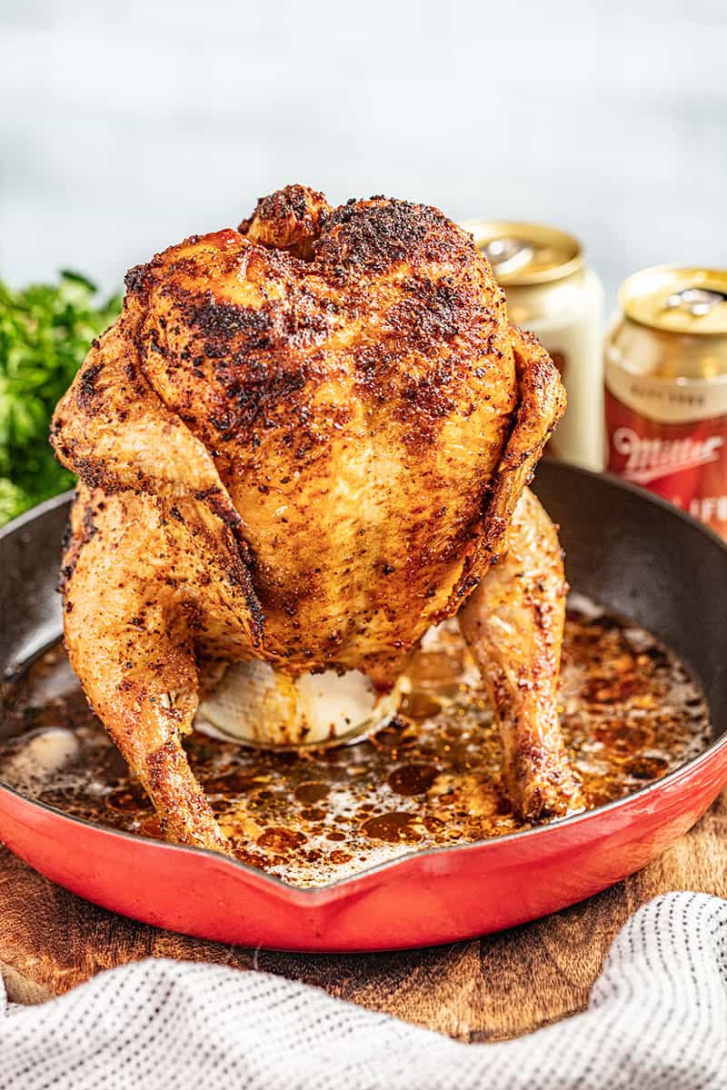 Roasted beer can chicken in a skillet.