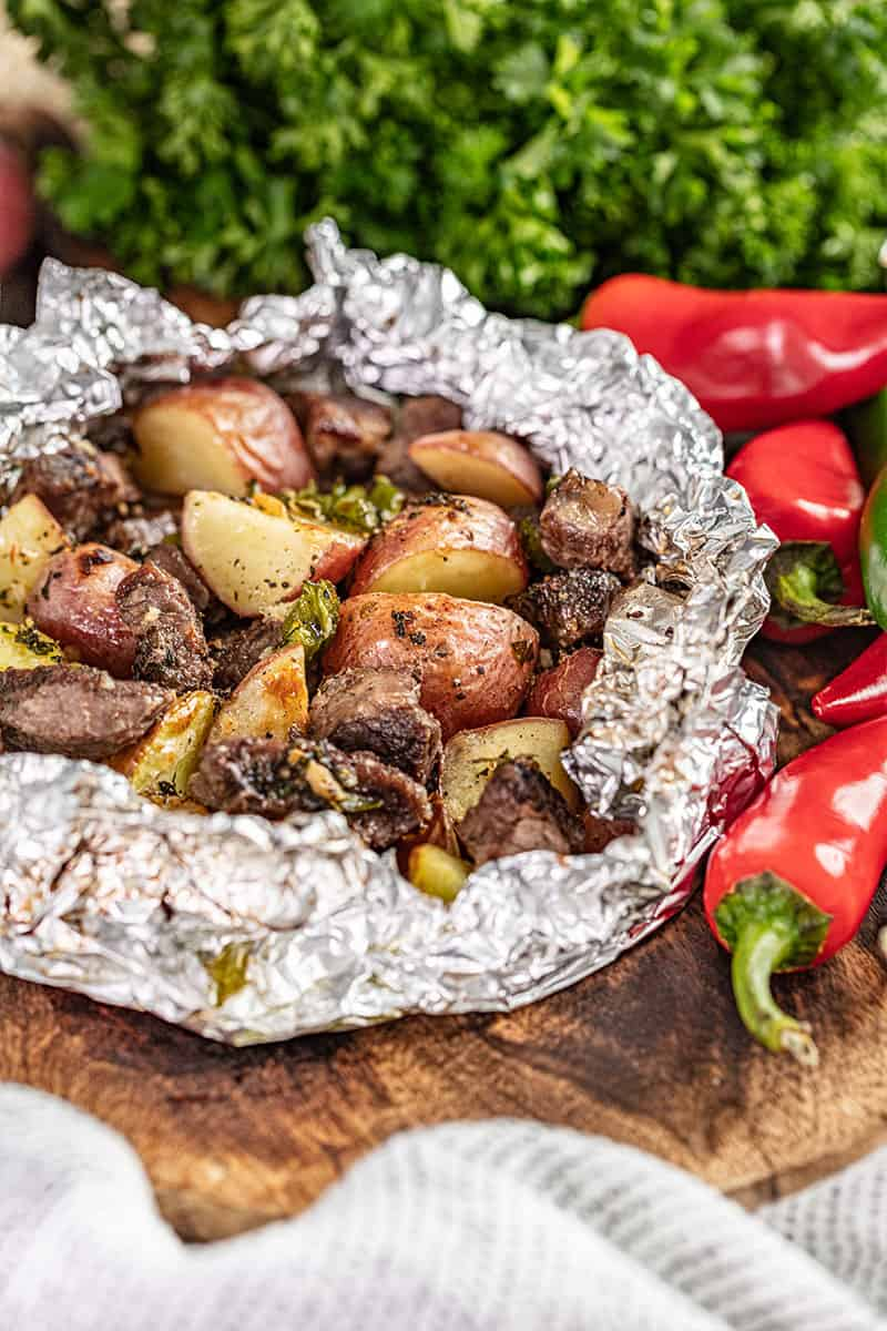 Steak and potatoes in a foil packet.
