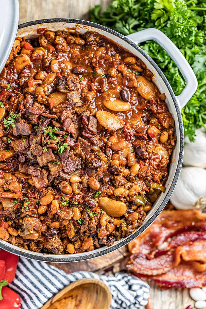 Overhead view of country style baked beans in a saucepan.