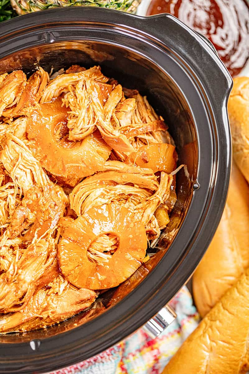Overhead view of Hawaiian barbecue chicken in a slow cooker.