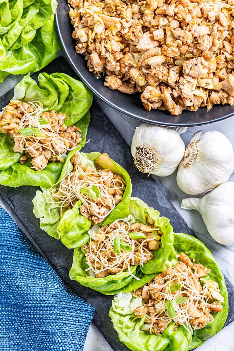 Overhead view of chicken lettuce wraps in a row.