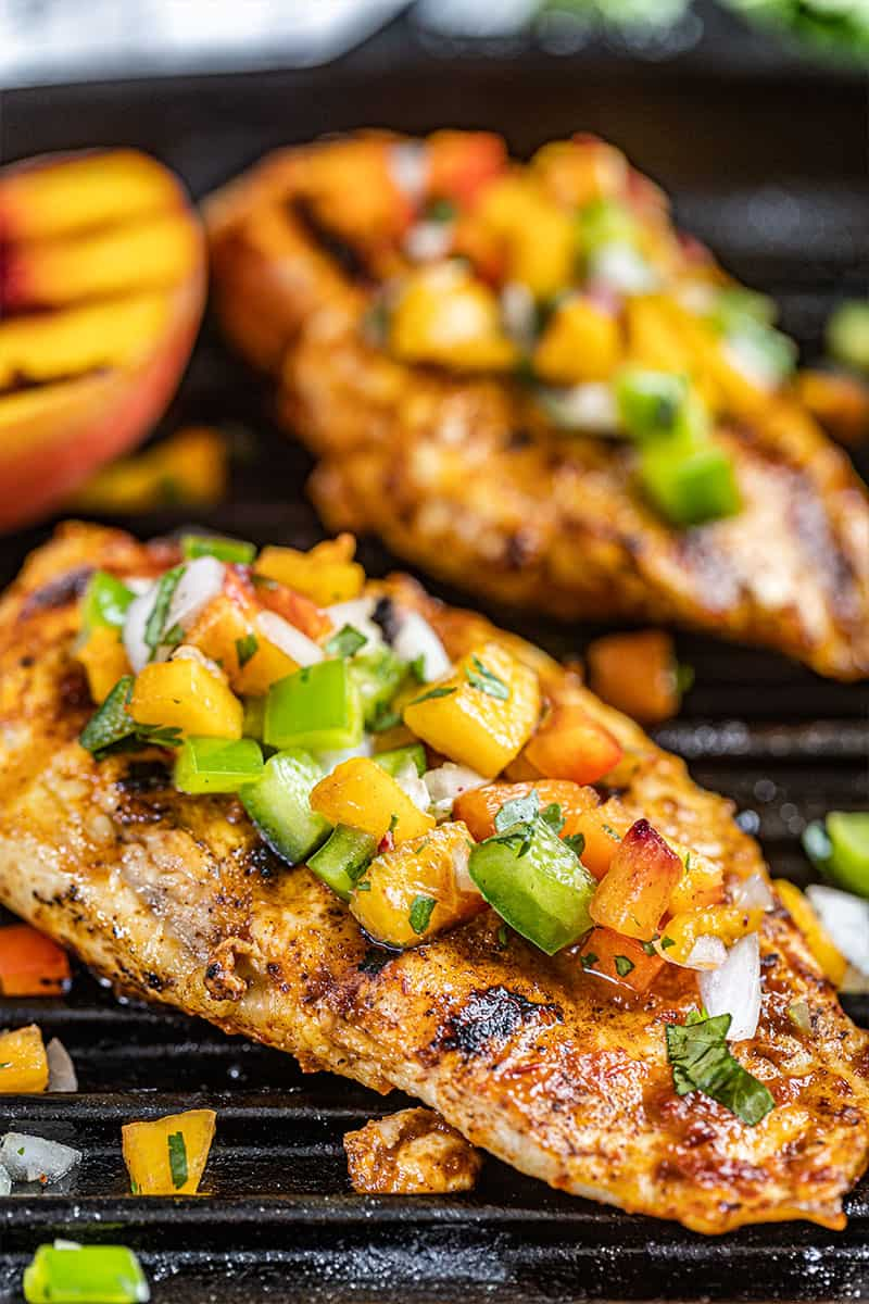 Close up view of a chipotle peach glazed grilled chicken breast.