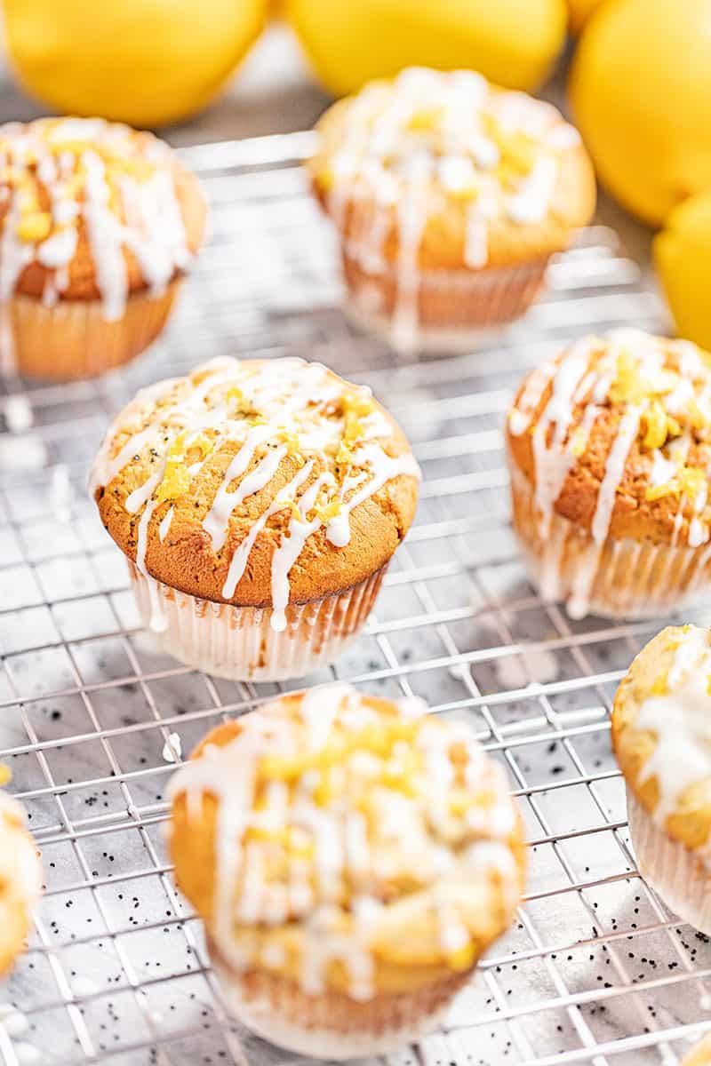 Lemon poppyseed muffins on a cooling rack.