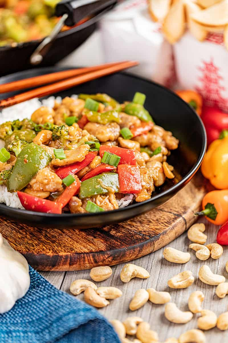 Takeout cashew chicken in a dinner bowl.