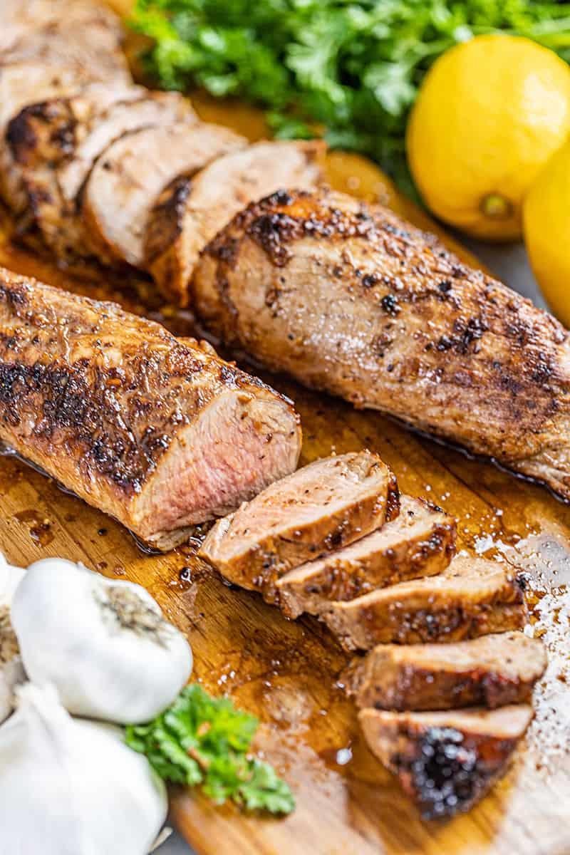 Pork tenderloin on a cutting board.