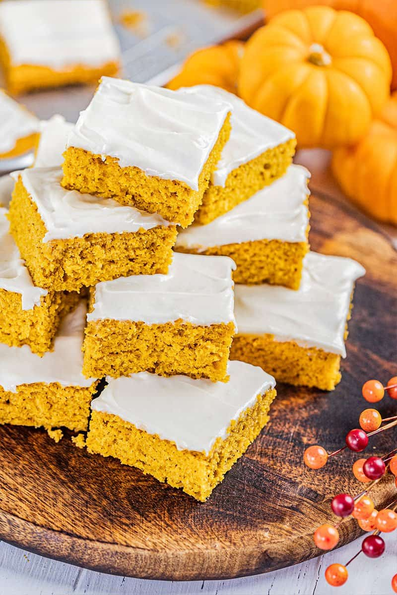 A stack of pumpkin bars on a serving tray.