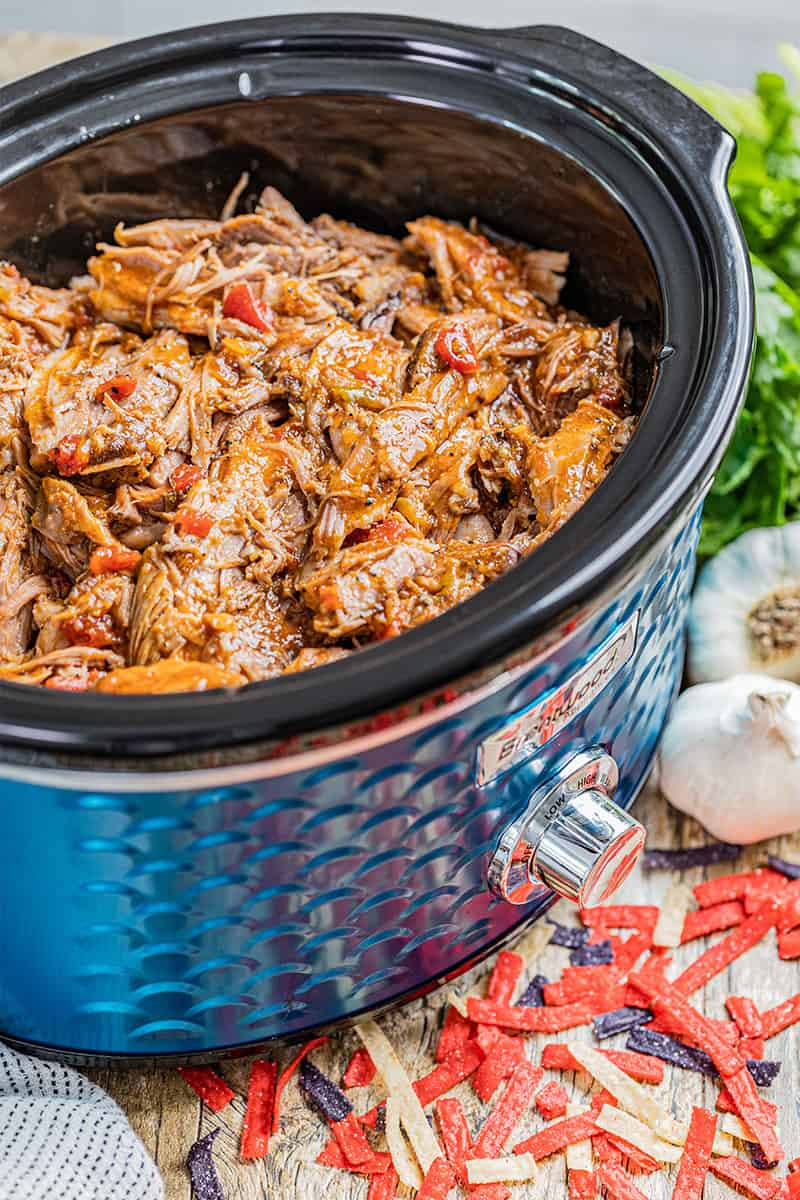 Slow cooker shredded sweet pork in a crock pot.
